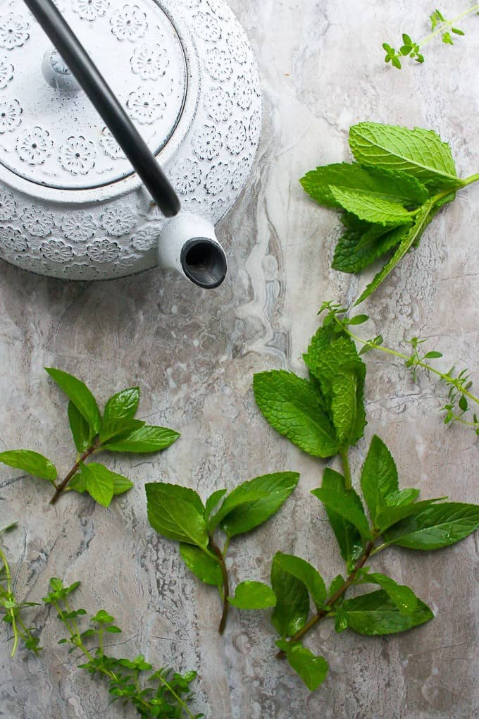 teapot and fresh mint leaves