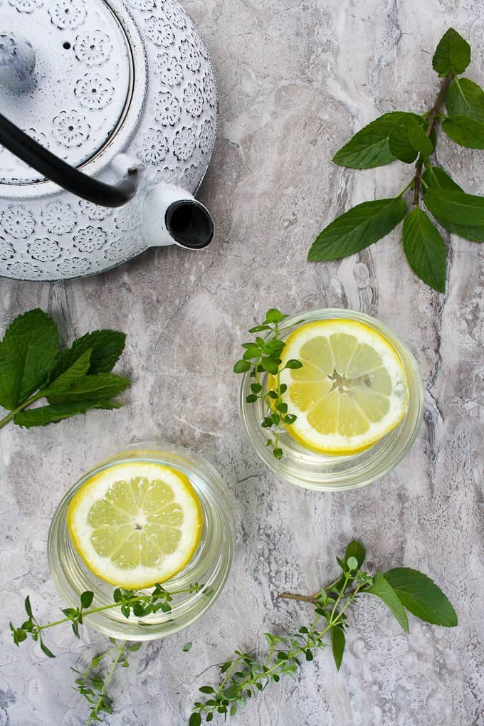 mint tea in glasses with a teapot and fresh mint