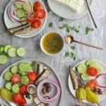 Greek salad without lettuce arranged onto plates