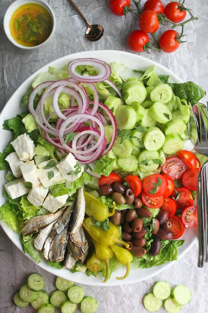 Greek salad with romaine in a serving bowl