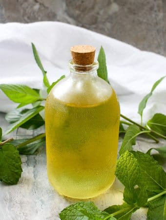mint simple syrup in a bottle