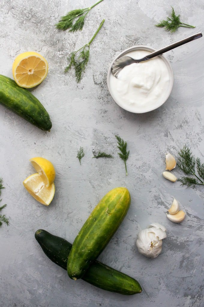 Homemade Tzatziki ingredients: Greek yogurt, dill, lemon juice, garlic, and cucumbers