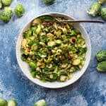 Shaved brussels sprouts salad in a serving bowl.