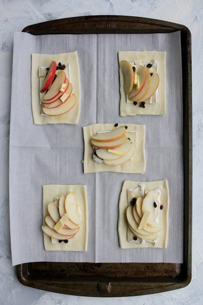 add apples and a dot of butter to the tarts
