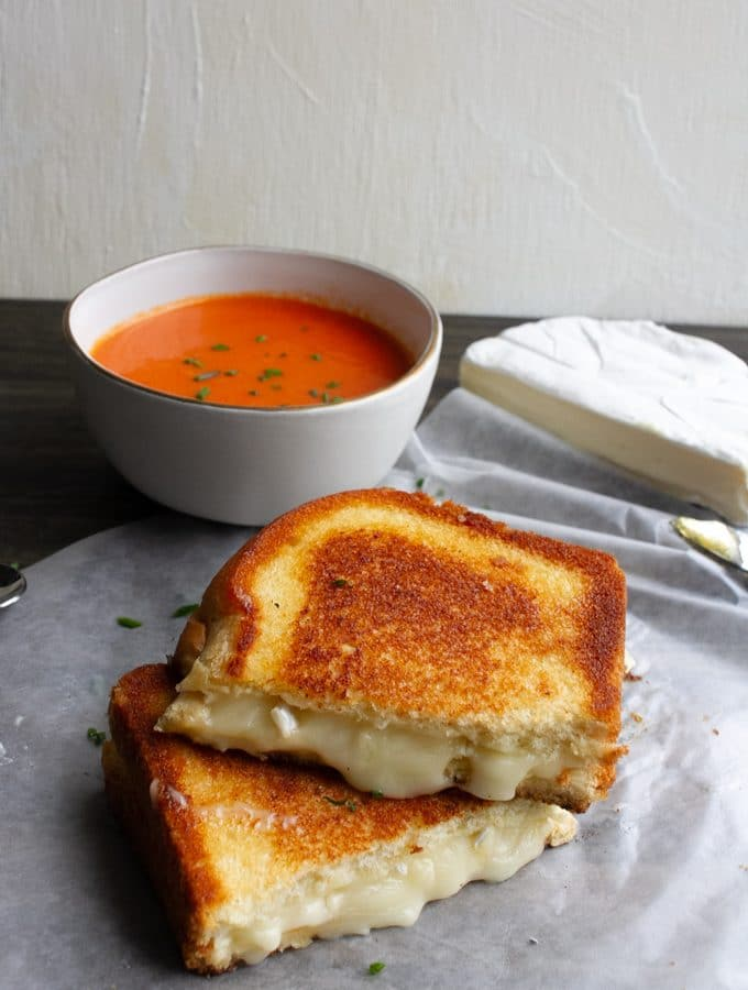 brie grilled cheese and a bowl of tomato soup