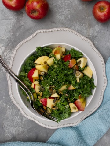 kale apple salad in a serving bowl