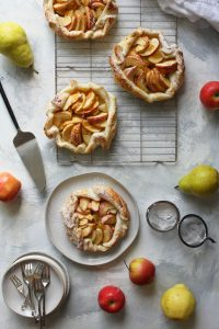 4 apple crostatas (galettes) on cooling racks + serving plate
