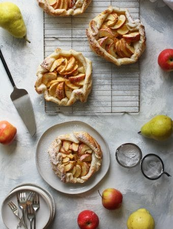 4 apple crostatas (galettes) on cooling racks + serving plate