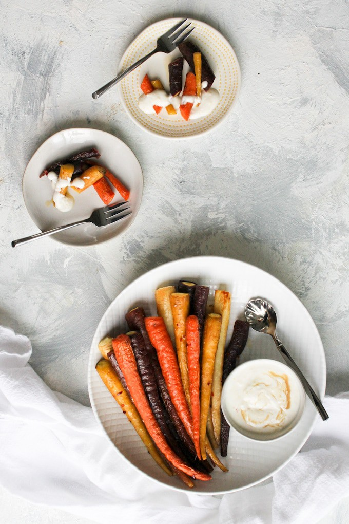 whole roasted carrots in a serving dish