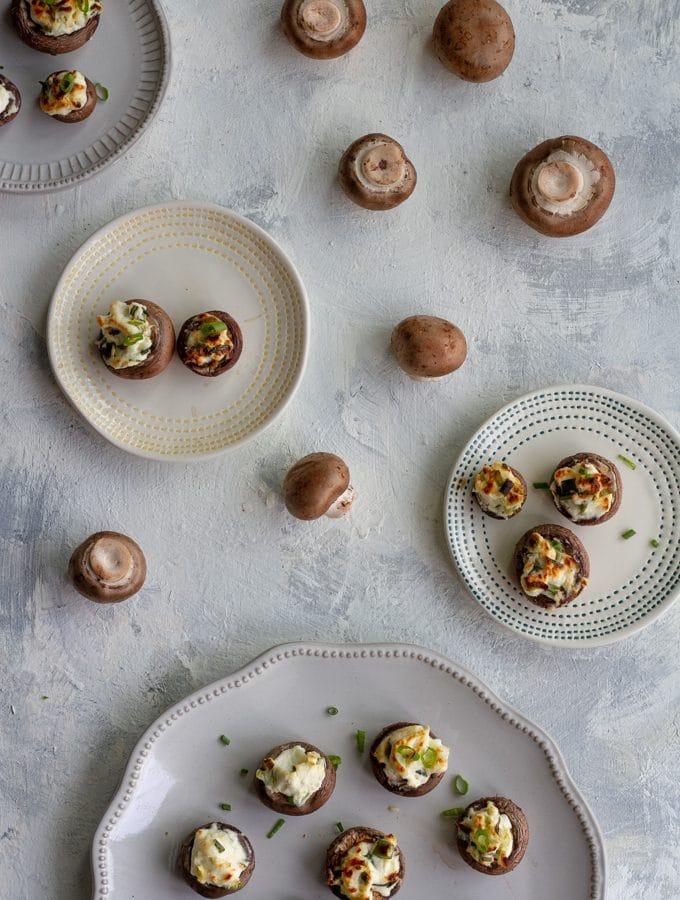 goat cheese stuffed mushrooms on a serving platter