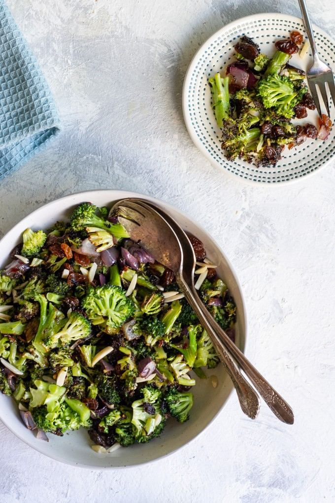 This vegan broccoli raisin salad is tossed with roasted onion almonds, and a mustard vinaigrette for an easy and healthy make-ahead side dish!