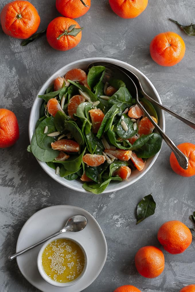 spinach mandarin orange salad in a serving dish