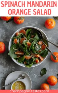 This vegan spinach mandarin orange salad is served with almond slivers and tossed in a quick Dijon vinaigrette for an easy spring side dish.