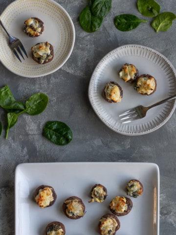 spinach stuffed mushrooms on a serving platter