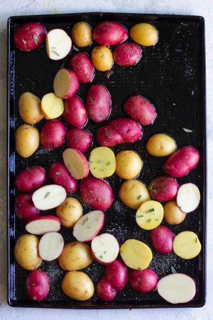 Halve Potatoes, Season, + Arrange on a Baking Sheet