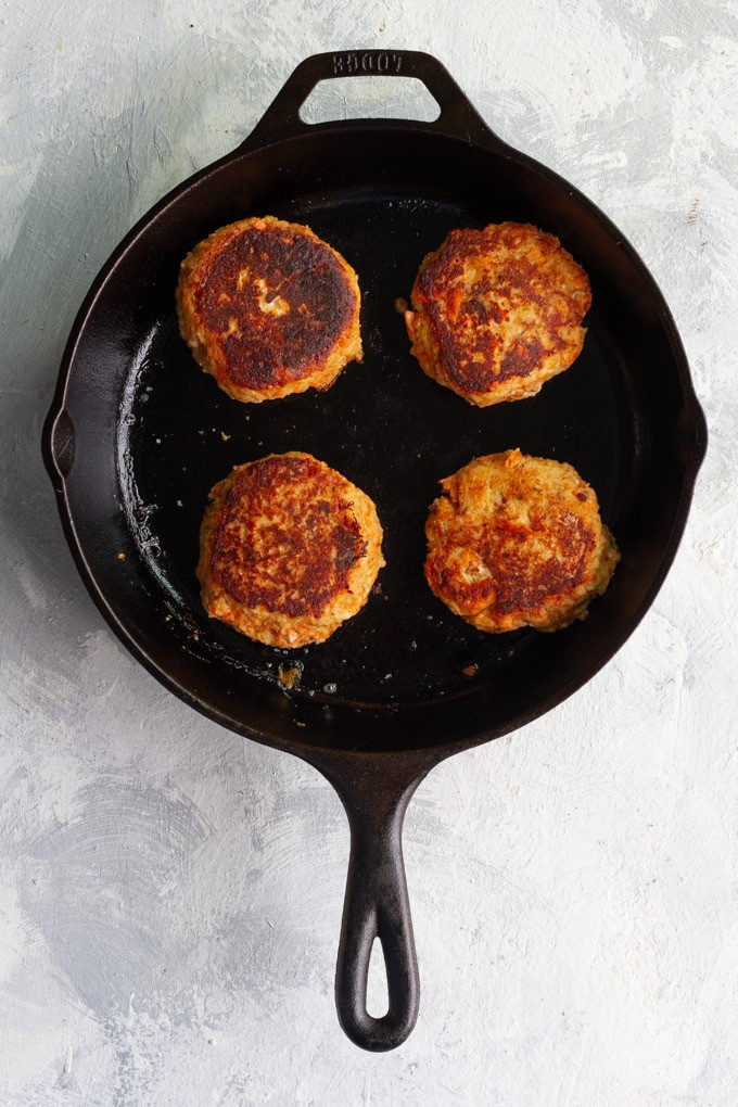 Sear salmon burgers until dark and golden