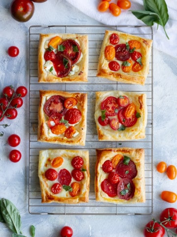 puff pastry tomato tarts on a cooling rack