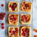 This easy tomato tart recipe is made with garden fresh herbs, summer tomatoes, soft cheese, and golden puff pastry.