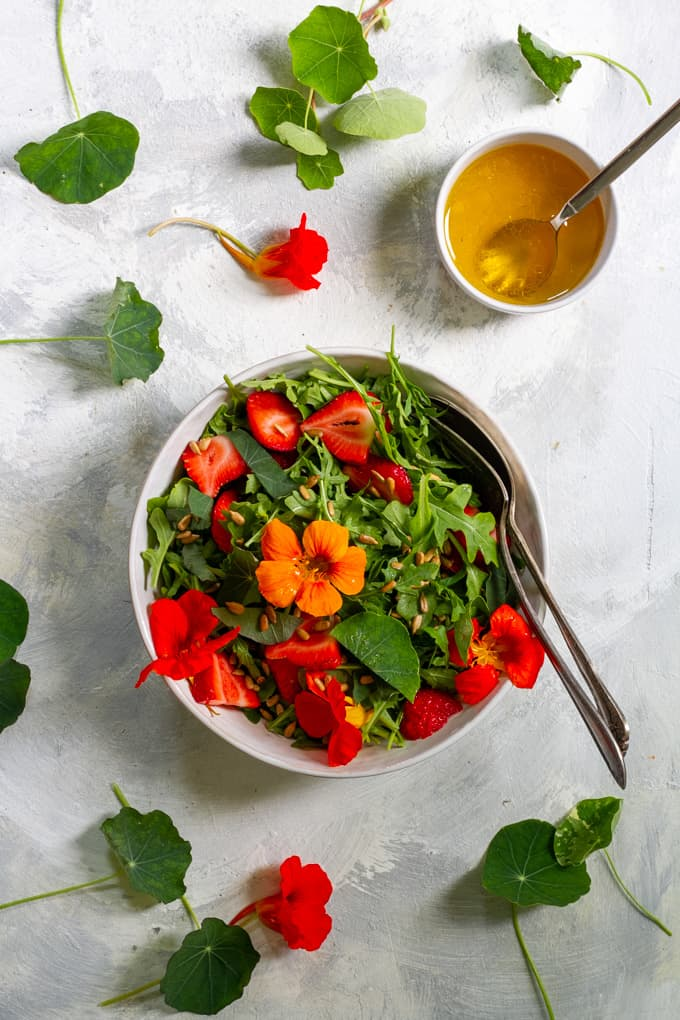 nasturtium salad with strawberries and vinaigrette