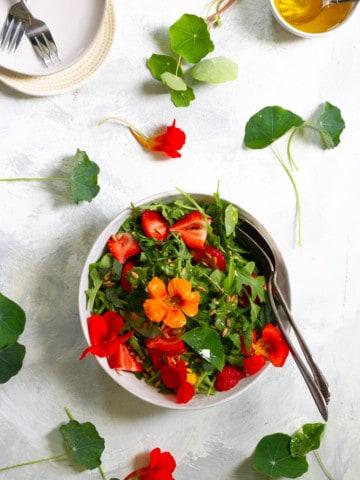 nasturtium salad with strawberries and vinaigrette