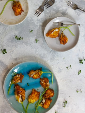 stuffed squash blossoms on a serving tray