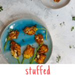 These easy stuffed squash blossoms are filled with herbs and goat cheese, and then pan fried. Serve them as a delicious summer appetizer!