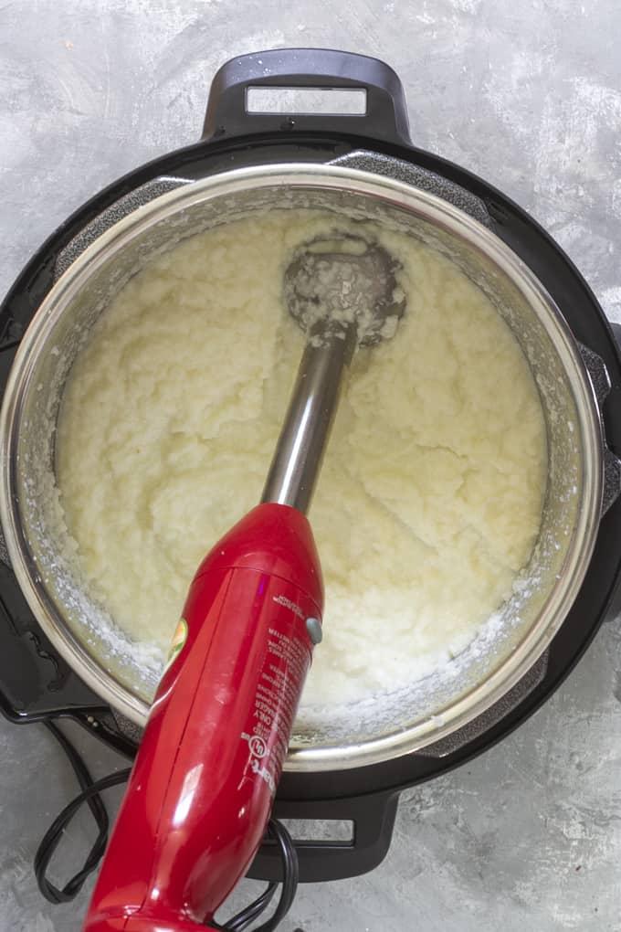 Blend instant pot mashed cauliflower until smooth