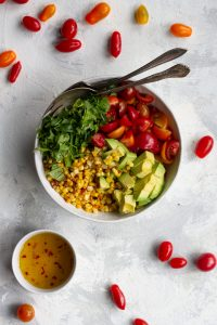 tomato corn salad in a serving dish