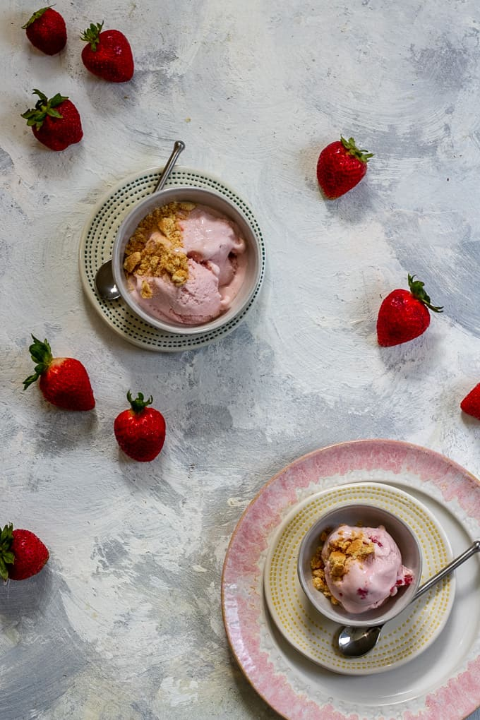strawberry cheesecake ice cream in serving bowls