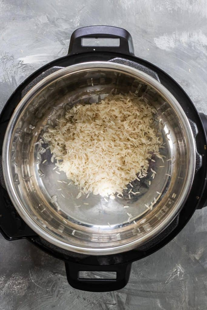 Add rinsed basmati rice to the Instant Pot