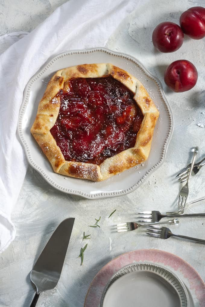 plum galette (plum pie) on a serving plate