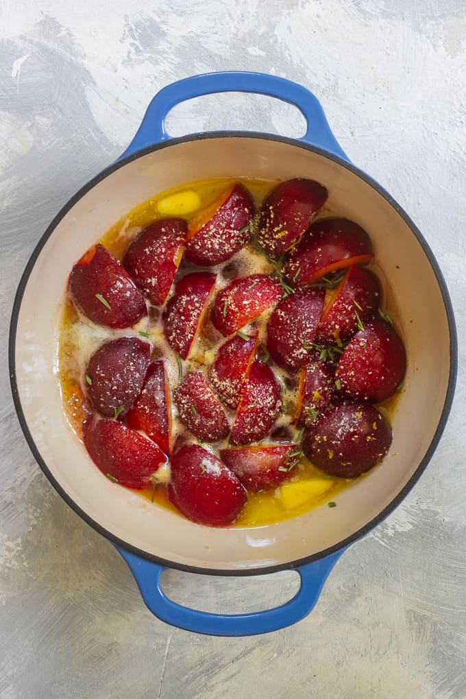 Add butter to the plums, + begin cooking
