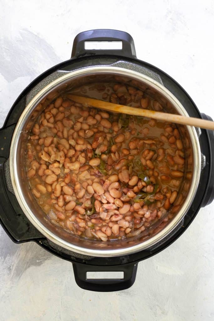 Pressure cook the beans until tender