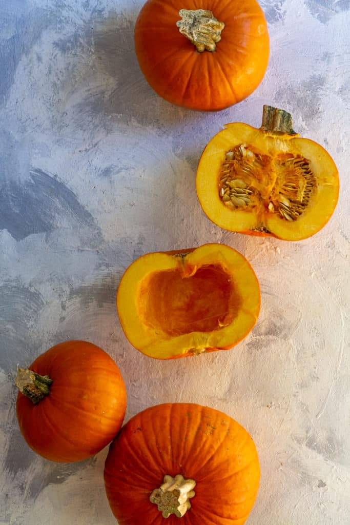Cut the Pumpkin in Half + Scoop Out the Seeds