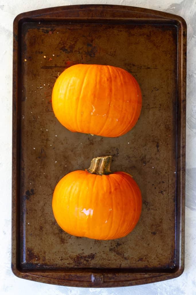 Place cut sugar pumpkin face down on a baking sheet