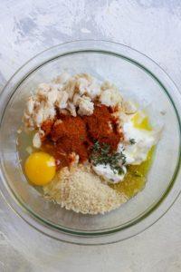 Mix crab cake ingredients in a bowl