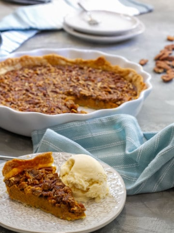 A slice of pumpkin pecan pie