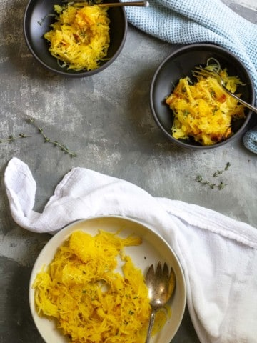 Roasted spaghetti squash in serving dishes