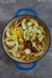 Add apple pie filling ingredients to a heavy-bottomed pot