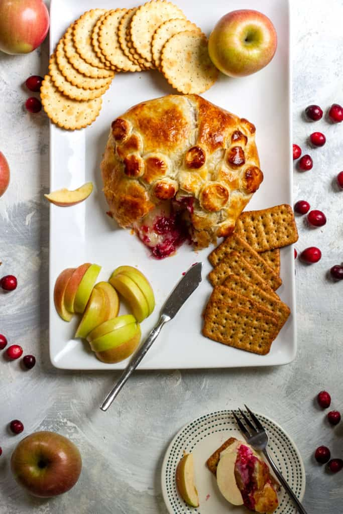 Cranberry Baked Brie with crackers and apples