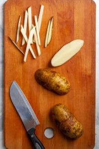 Cut potatoes into long thin strips