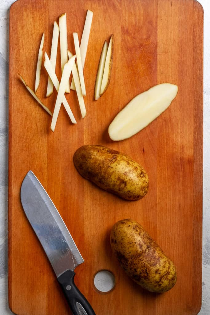 Cut potatoes into long thin strips