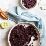 Black rice with lime dressing in a serving dish