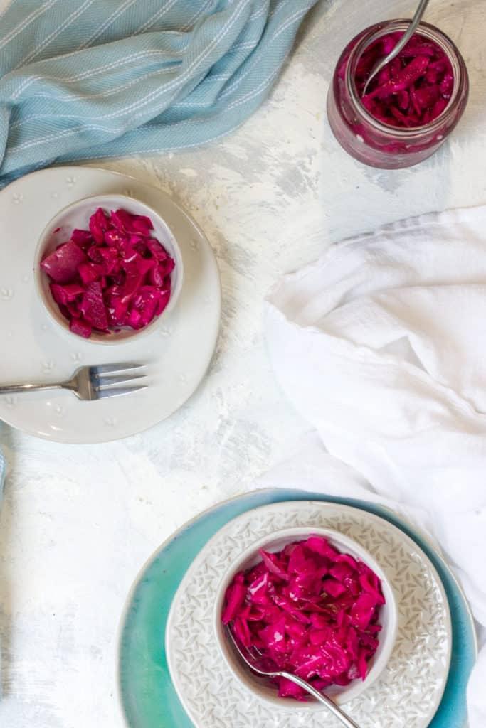 Red cabbage sauerkraut in serving bowls