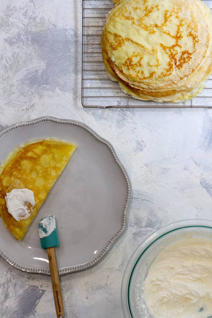 Fold the Crêpe in Half + Top with More Cream