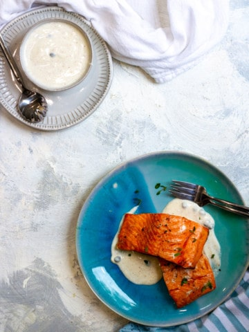 Air Fried Salmon on a plate with Yogurt sauce