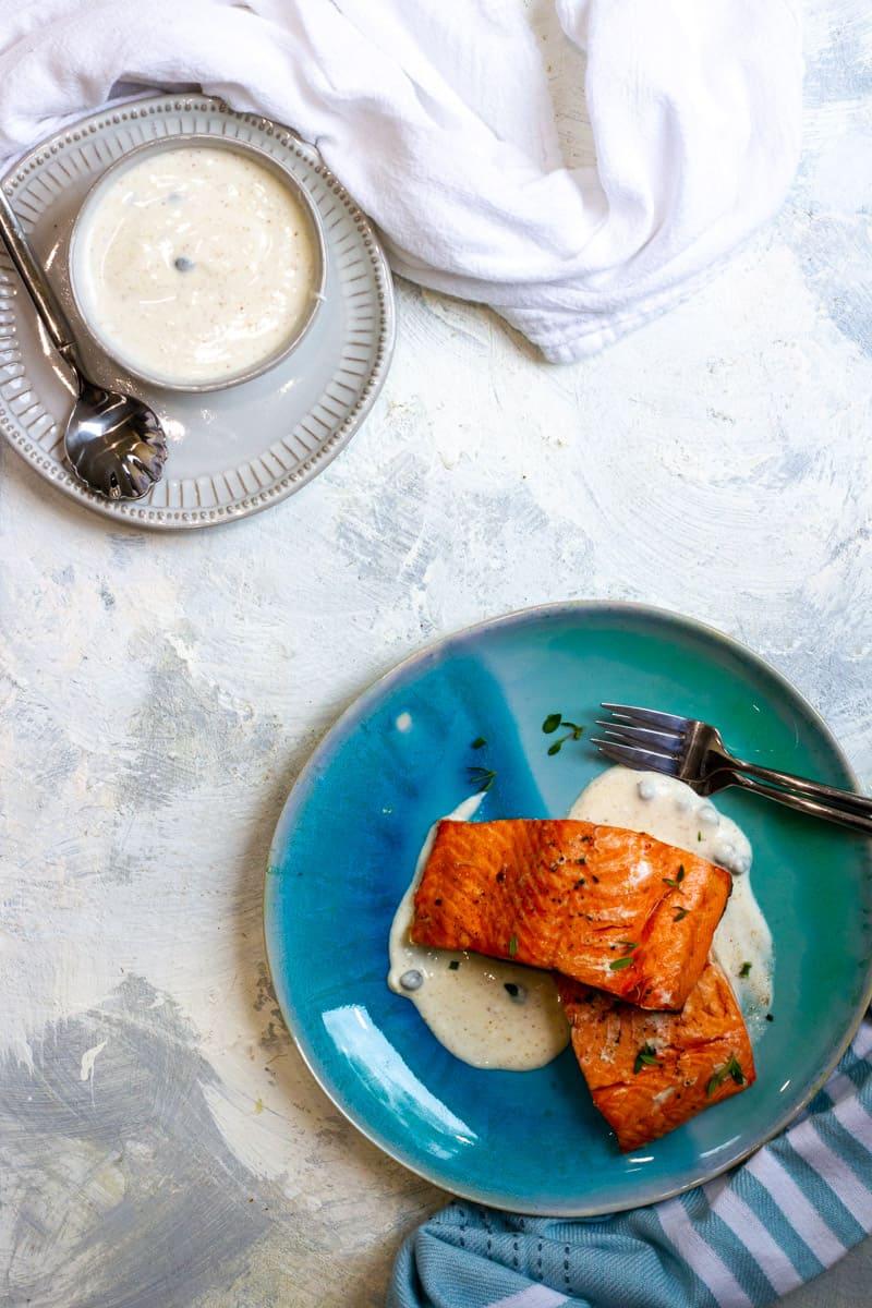 Air Fried Salmon on a plate with Yogurt sauce