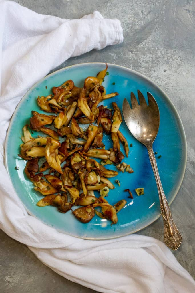 Sautéed oyster mushrooms on a serving dish