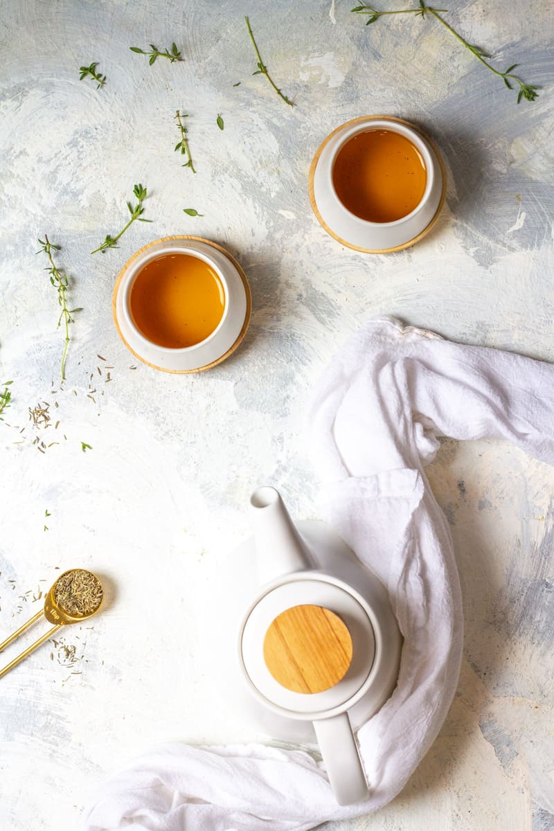 thyme tea in a teapot and tea cups