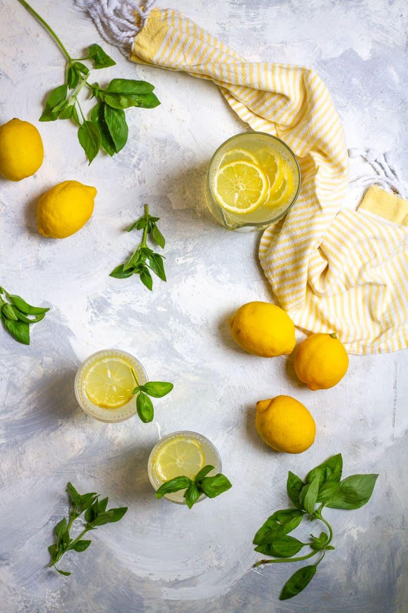 basil lemonade in a pitcher + in glasses